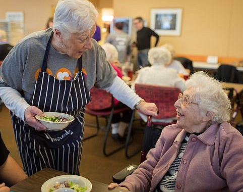 Volunteer Serving Resident at Riverview Towers